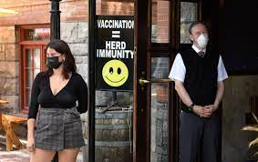 Canada tops world in inoculated populace as new COVID-19 cases fall under 1,000